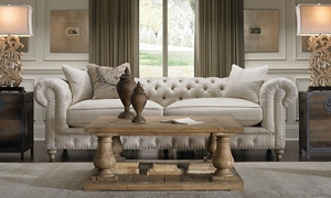 White 20th century style chesterfield sofa adorned with tufted detailed upholstery and feather down blend seating in an all natural cotton linen.