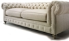 Exquisite 20th century style chesterfield sofa in white with hand-tufted detailed backing and feather down blend seating in an all natural cotton linen.