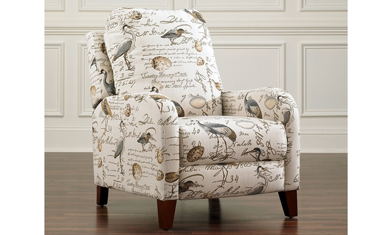 Beautiful contemporary push back recliner arm chair hand tailored in an upholstered bird patterned fabric with wooden ball turned stretcher feet.