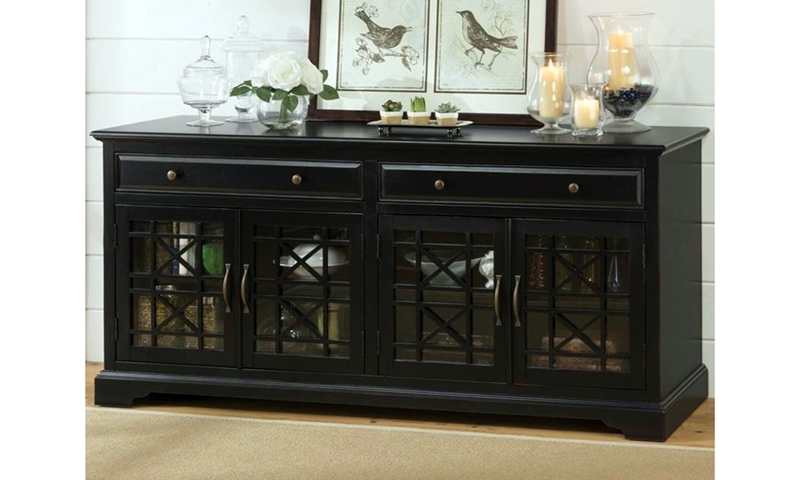 "70"" craftsman style media console with intricate antique brass hardware dressed in a modern black finish with 2 drawers and  four glass doors."