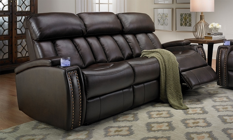 Chocolate-colored power reclining sofa in top-grain leather with padded power adjustable headrests, USB charging ports, & drop down table.