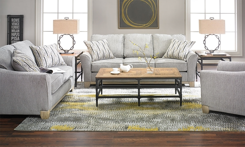 Artifact flare arm sofa in pewter gray upholstery with exposed wood in living room
