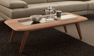 Get a chic mid-century modern Natuzzi cocktail table featuring a tempered glass inset, round edges, and splayed tapered legs in a light bronze finish.