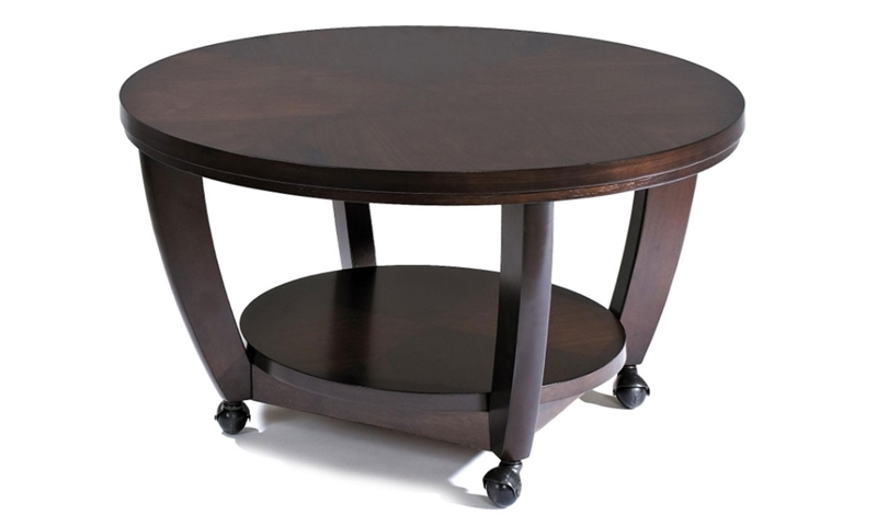 "38"" round contemporary cocktail table featuring bowed legs, a lower storage shelf, and casters for mobility in a warm walnut brown finish."