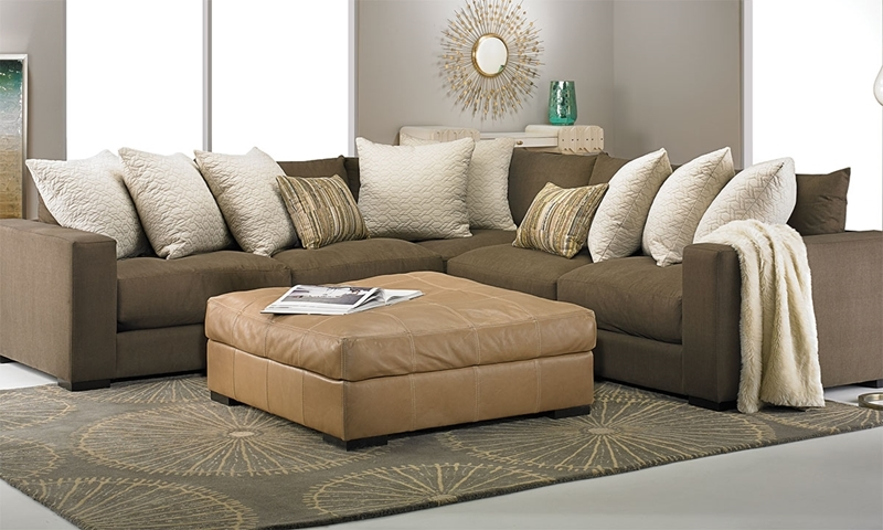 """Contemporary track arm sectional in breathable chocolate Livesmart fabric featuring 42"""" resilient foam deep seat cushions & 9 large & 2 small toss pillows."""