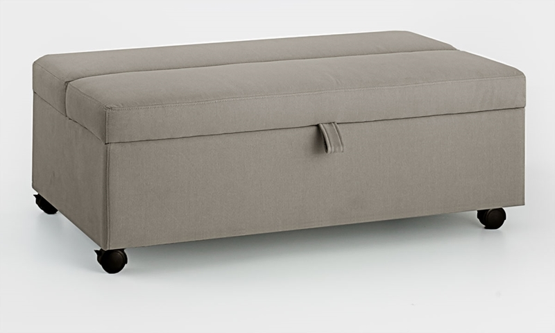 Gray space-saving ottoman with casters includes twin size gel foam mattress