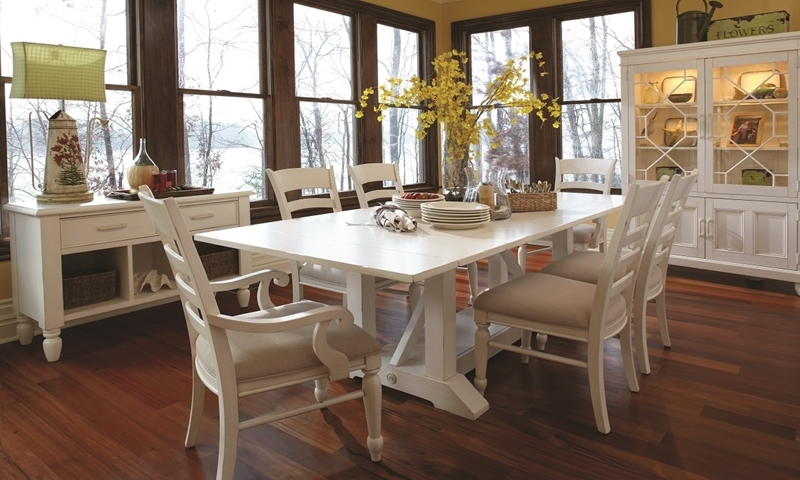 Klaussner Sea Breeze 7-Piece Casual Coastal Trestle Dining Set with 96-inch trestle table, four side chairs and two arm chairs in antique white