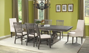 Stone Acacia 5-Piece Trestle Dining Set with 76-inch table, extendable to 112-inches with two drop-in leaves and 4 lath back chairs with cream linen-like cushions in dark ash finished acacia veneers.