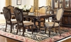 Grand Estates 5-Piece Old World Dining Set II with 72-inch pedestal table extendable to 108-inches and four upholstered lute-back side chairs with gold upholstery - Dining Room Shot