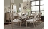 Bridgewater Weathered Oak 7-Piece Trestle Dining Set with 118-inch extendable table, four side chairs and two arm chairs with neutral upholstery - Room Shot
