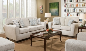 Uptown American-Made Dome Arm Sofa in Cream Upholstery atop Dark Tapered Feet
