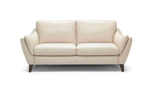 Contemporary Natuzzi flare arm sofa comes with padded flare arms supported by a durable hardwood frame in a casual cream colored Italian leather.