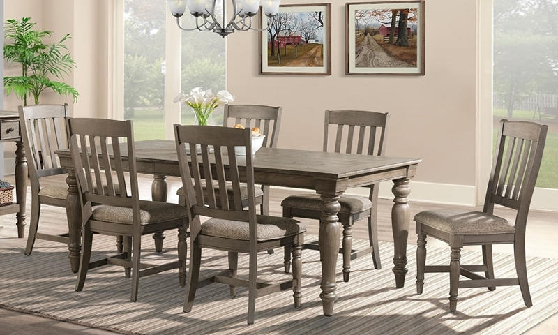 Casual 5-piece dining set with 60-inch table with self-storing leaf and four slat back chairs in oak finish
