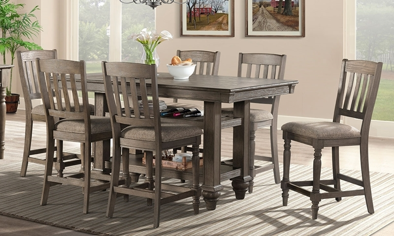 Casual 5-piece counter-height dining set with 66-inch storage table and 4 stools in oak finish.