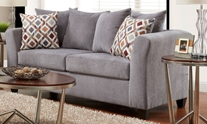 Transitional fabric sofa in gray upholstery with pillowback and throw pillows.