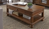 Traditional whiskey brown coffee table with storage drawer and casters in living room