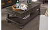 Traditional peppercorn gray coffee table with storage drawer, shelf and casters in living room