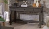 Traditional peppercorn gray sofa table with open storage drawer in living room
