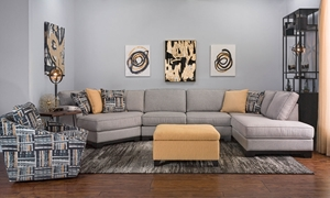 Living room with modern sectional sofa with cuddler and 85-inch chaise, contrasting patterned chair and ottoman