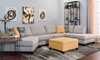 Living room with modern sectional sofa with cuddler and 85-inch chaise and yellow ottoman