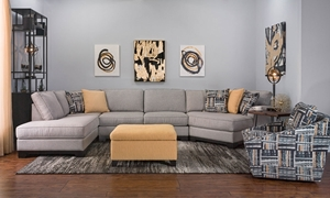 Living room with sectional sofa with right arm cuddler and 89-inch chaise, contrasting patterned chair and yellow ottoman