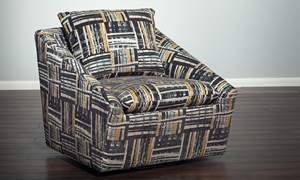 Contemporary swivel chair in grey, teal and yellow abstract patterned upholstery - Angled view