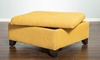 32-inch square storage ottoman in gold upholstery with dark wood feet - open top