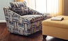 Living room with multicolored pattern and gold square storage ottoman