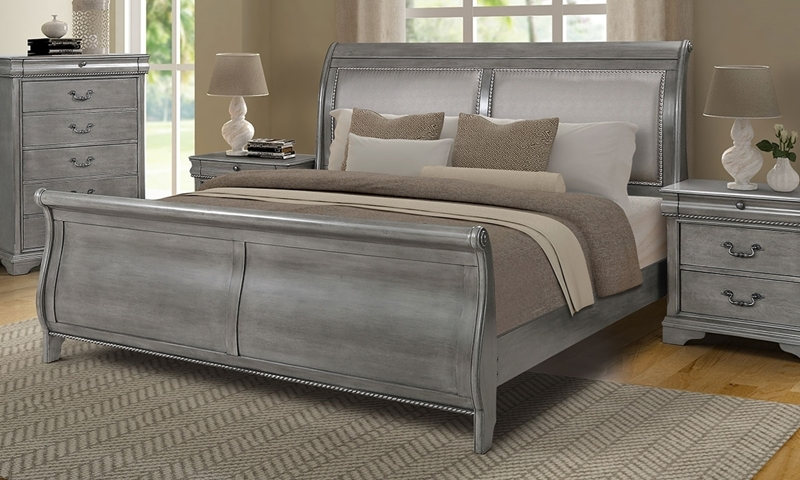 Louis Philippe style king bed with cream upholstered headboard, dresser and nightstand in platinum gray finish