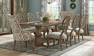 Casual dining set with double pedestal extendable light wood dining table, round lattice back side chairs and upholstered patterned captains chairs from the Trisha Yearwood Jasper County collection