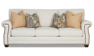 Traditional upholstered living room sofa with nailhead trim and roll arms in natural tone from Trisha Yearwood Lawrence Collection - Front View