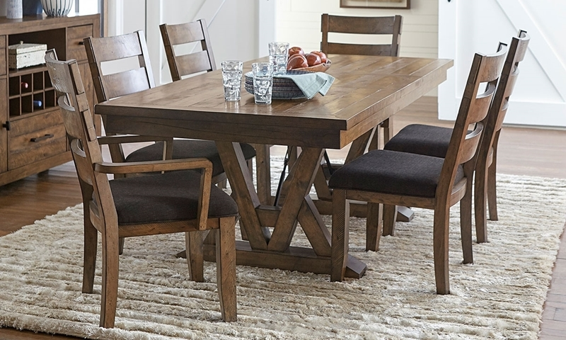Casual dining set with 66-inch planktop trestle table and ladder-back chairs with grey upholstered cushions