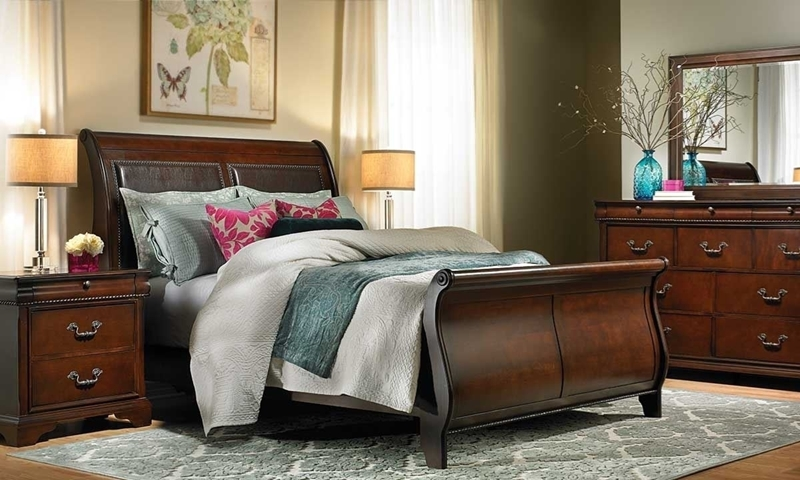 Louis Philippe style bedroom suite with sleigh bed, 10-drawer dresser with mirror and nighstand in chestnut brown finish