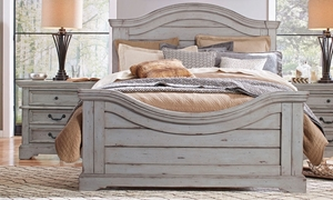 Queen bed with wood plank panels and arched headboard and footbard in antique grey finish