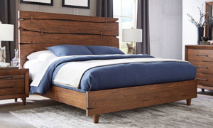 Solid pine  king bed with live edge panel in brushed brown finish in bedroom with dresser and nighstand