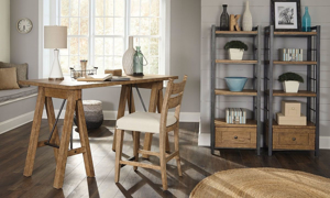 Home office with saw horse style wood desk, chair and display shelves in wheat finish