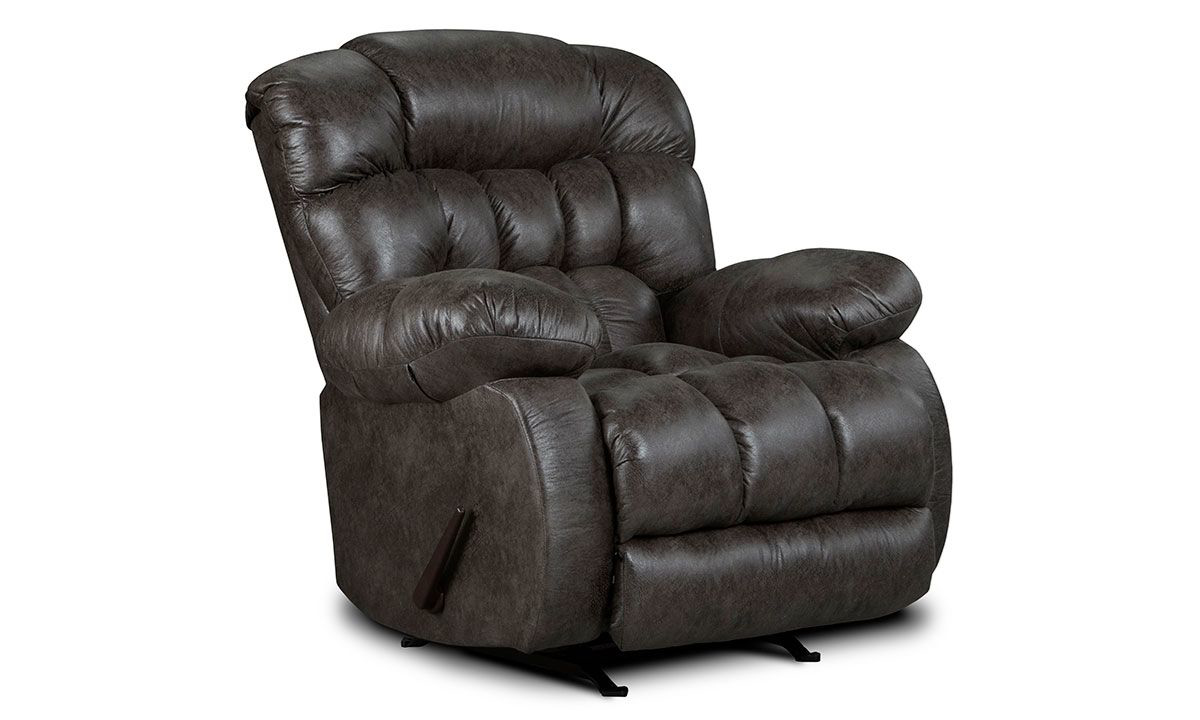 Overstuffed rocker chair in ash grey upholstery with manual recliner and triple pillow back.