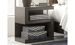 Contemporary S-shaped nightstand with two open shelves in greystone finish