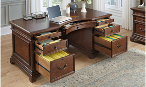 Traditional cherry desk with 7 open drawers in home office