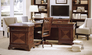 Complete executive home office with L-shaped desk and chair in cherry finish