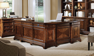 Complete executive home office with L-shaped desk and chair in cherry finish - Front View