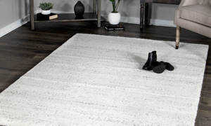 Naima Ari Cream Area Rugs