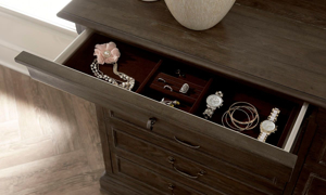 Close-up of felt-lined jewelry drawer on 10-drawer dresser from the ART St. Germain Collection