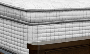 """Luxury 14"""" Restonic euro top mattress with gel memory foam and wrapped coils on bed"""