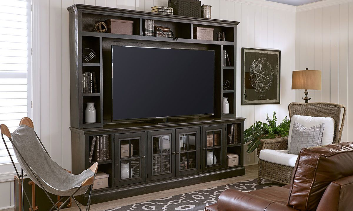 96-inch entertainment wall unit includes hutch with open shelving and console with glass paned storage cabinets and open shelves in ghost black