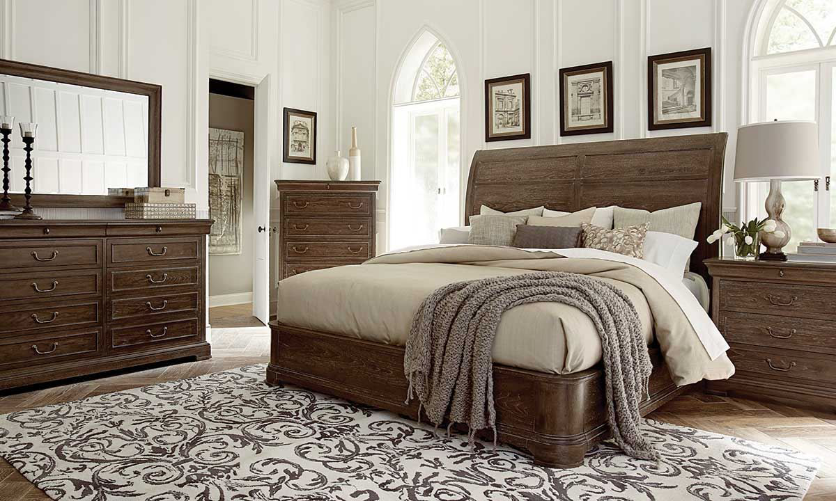 Complete bedroom set with sleigh bed, dresser with mirror, chest and nightstand in warm coffee brown finish from ART