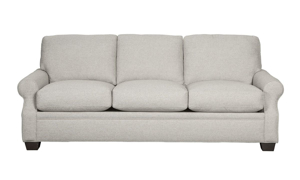 Sustainable sofa made of recyled materials with roll arms.