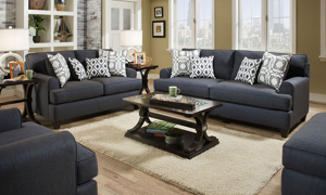 Room scene with Andover Navy Blue Fabric sofa and loveseat with matching throw pillows.