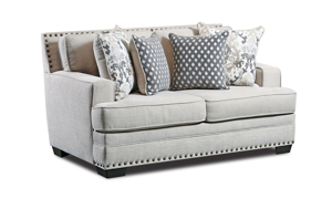 American-made fabric upholstered loveseat in a cream color with coordinating toss pillows.