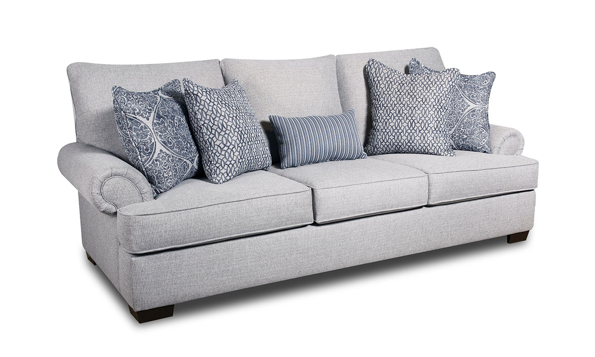 Light grey traditional sofa with coordinating patterned throw pillows
